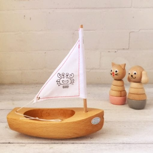 toy wooden boat white sail